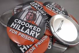 """Crooked Hillary For Prison"" campaign buttons echoing Donald Trump repeated rallying cry to jail his political opponent Hillary Clinton"