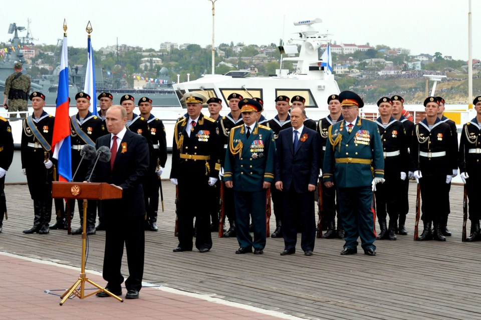 Putin speaking in occupied Sevastopol on the anniversary of the WW2 Victory Day to celebrate the annexation of the Crimean peninsula from Ukraine conducted by his military and special services two months earlier. May 9, 2014 (Image: AFP PHOTO/ YURI KADOBNOVYURI KADOBNOV/AFP/Getty Images)