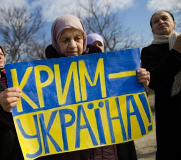 Crimean Tatars attend a pro-Ukraine rally in Simferopol during the Russian special operation to annex Crimea. March 14, 2014.