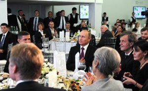 "Former US national security advisor, former Director of US Defense Intelligence Agency, retired Lieutenant General Mike Flynn at a conference and gala dinner celebrating the 10th anniversary of Russia's propaganda arm, media channel ""RT"" (formerly ""Russia Today"") seated at the head table at the gala, with Vladimir Putin, his then-chief of staff, Sergei Ivanov and press spokesman Dmitry Peskov, among other Russian officials. December 10, 2015 in Moscow. (Image: Kremlin press service)"