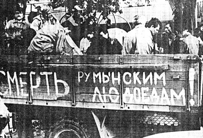 "The truck's body reads, ""Death to Romanian man-eaters"". Transnistria, Moldova, 1992."