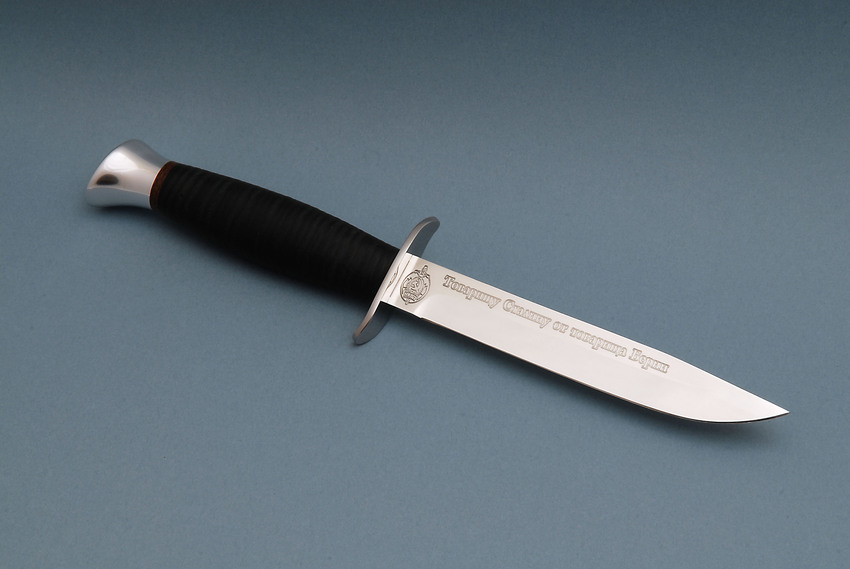 """A Russia-produced replica of the knife Beria, the infamous head of the NKVD (an earlier name for the organization later known as the KGB) gave to Stalin as a gift at the hight of the repressions the two conducted in the end of the 1930s when millions of Soviet citizens were murdered and sent to GULAG concentration camps. It has the emblem of the NKVD and an engraving: """"To Comrade Stalin from Comrade Beria."""" (Image: i-korotchenko.livejournal.com)"""