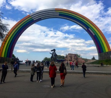 The Friendship of Nations Arch, an old Soviet monument in Kyiv, painted as a rainbow for the 2017 Eurovision Song Contest. The painting is unfinished to symbolize Ukraine's incomplete liberation from Russia. (Image: @DaveKeating via Twitter)