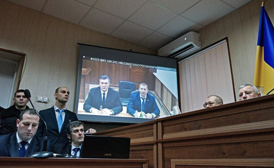 Ukrainian ex-President Yanukovych testified on the monitor in the Sviatoshyn district court of Kyiv via a video broadcast. Photo: https://cont.ws