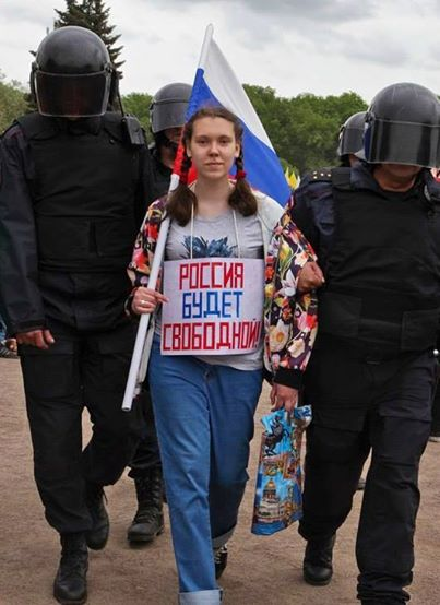 "Girl arrested during protests on 12.06.2017 with sign ""Russia will be free."" Photo: Georgy Markov"