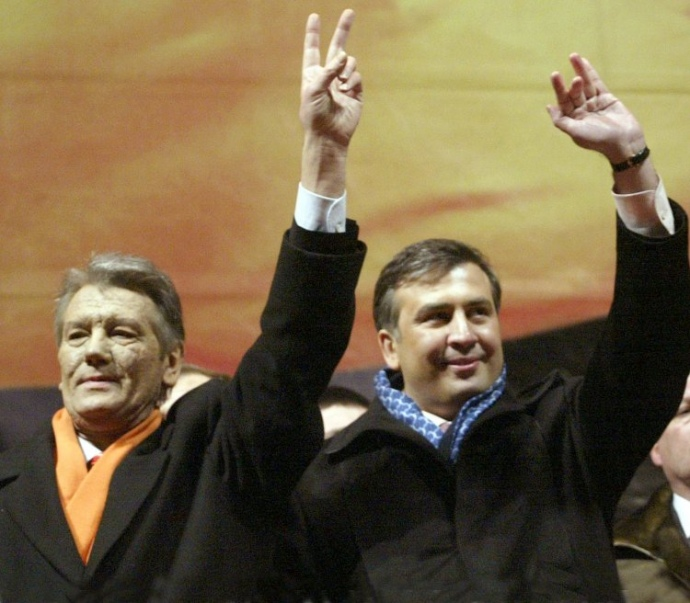Saakashvili stands next to presidential candidate Viktor Yushchenko during the Orange revolution of 2004