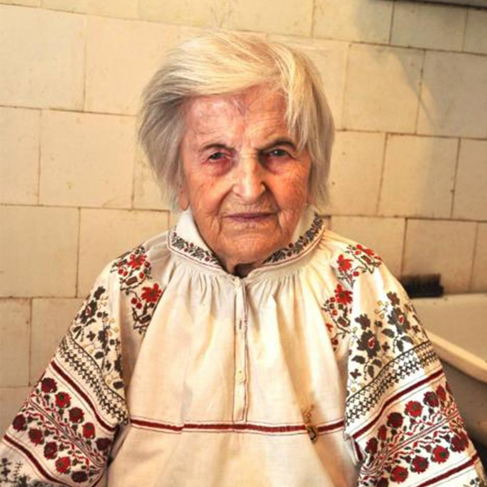 Olha Ilkiv wearing the embroidered shirt she sewed in prison from prison sheets. She treasures this memento and wears it only on important holidays and celebrations.
