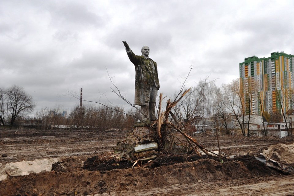 "Moss-covered ""last Lenin in Kyiv"" found after decommunization. The monument was recently discovered by construction workers while building the new Ring Road. Photograph: iloveobolon.kiev.ua"
