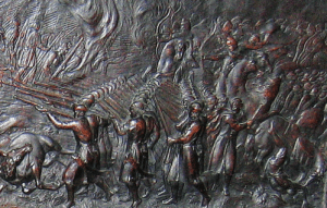 Kozaky shooting with firearms. A fragment of a bas-relief on the sarcofagus of John II Casimir Vasa, king of Poland in the 17th c. Source: Wikimedia Commons