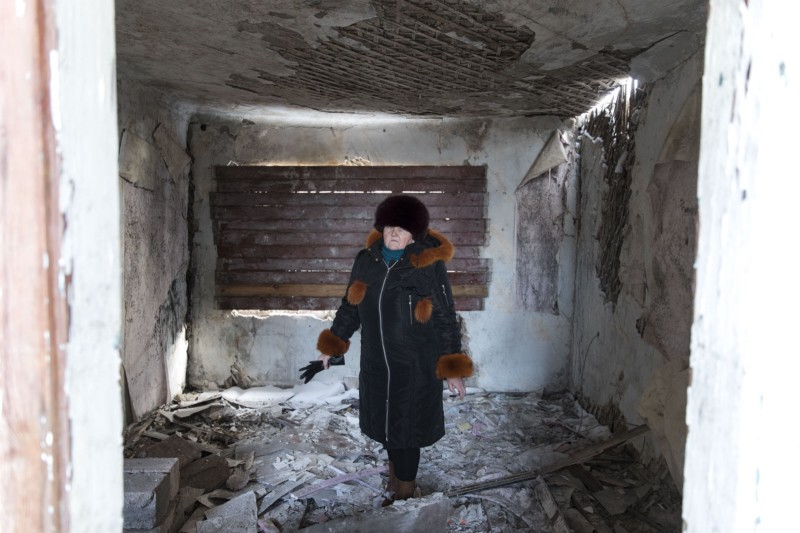 Iryna stands in her home void of all her possessions.