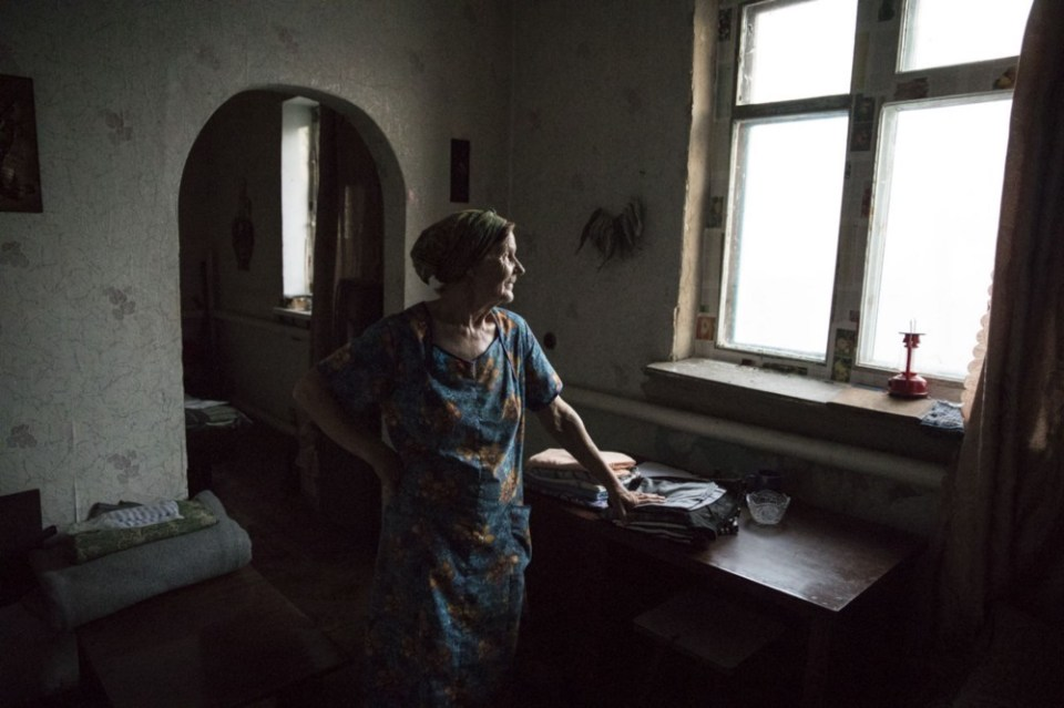 Nadiia remains in the town of Opytne looking after pets of neighbors who have since left.