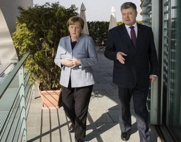 https://www.eurointegration.com.ua/images/doc/7/9/79c2ba1-mercel-poroshenko-625.jpg