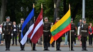 Military with state flag of the Baltic states: Estonia, Latvia and Lithuania