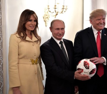 Putin and the Trump couple pose with a soccer ball Putin gave Donald Trump earlier following their one-on-one (with translators only) meeting in Helsinki, Finland on July 16, 2018 (Image: kremlin.ru)