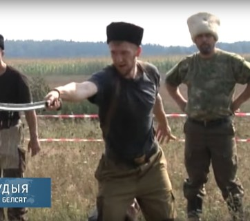 Saber training of Russian pseudo-Cossacks on the border with Belarus (Image: Screen capture of Belsat video on YouTube)