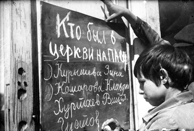 Young Pioneers denounce classmates suspected of celebrating Easter, 1930s (The Young Pioneers, was a mass youth organization of the Soviet Union for children aged 9–15 that existed between 1922 and 1991)