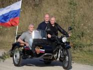 Vladimir Putin riding a three-wheel motorcycle in occupied Crimea with the head of the Russian occupation administration of Crimea Sergey Aksyonov and the acting mayor of Sevastopol Mikhail Razvozhayev (L-R) on August 10, 2019. Photo: kremlin.ru