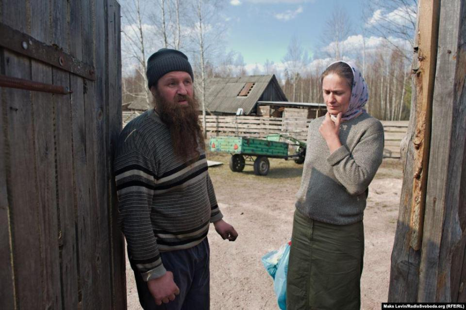 Locals of the village of Lichmani, father Alexander and his wife Natalia. They saved their home from a fire. Part of the hives burned down, sheep lost