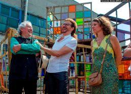 Artist Daniel Buren, gallery owner Lorenzo Fiaschi, and philanthropist Lyubov Mykhailova in front of an installation in Izolyatsia, pre-war Donetsk. Photo via RFE/RL