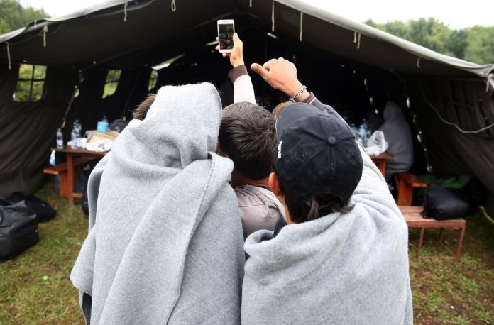 A group of children taking a selfie, at the Refugee Aid Center in Šid, Serbia