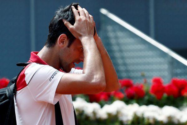 GRAF2732. MADRID, 09/05/2018.- El tenista serbio Novak Djokovic tras perder con el británico Kyle Edmund, en partido de segunda ronda del Mutua Madrid Open que se disputa en la Caja Mágica. EFE/Mariscal