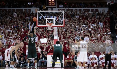 February 9, 2014: Wisconsin students try to distract Michigan State Spartans center Adreian Payne (5) during a free throw attempt, as the Wisconsin Badgers defeated the 9th ranked Michigan State Spartans (60-58) at the Kohl Center in Madison, WI. (Photo by Dan Sanger/Icon SMI/Corbis via Getty Images)