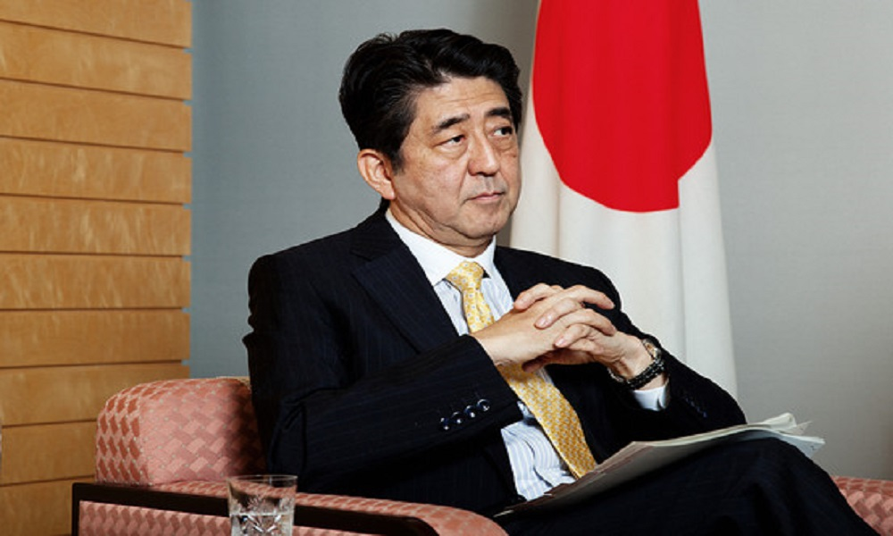 Japan's Shinzo Abe talks up casino business, promises safeguards