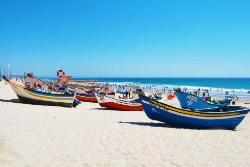 Boats on Costa da Caparica beach Portugal
