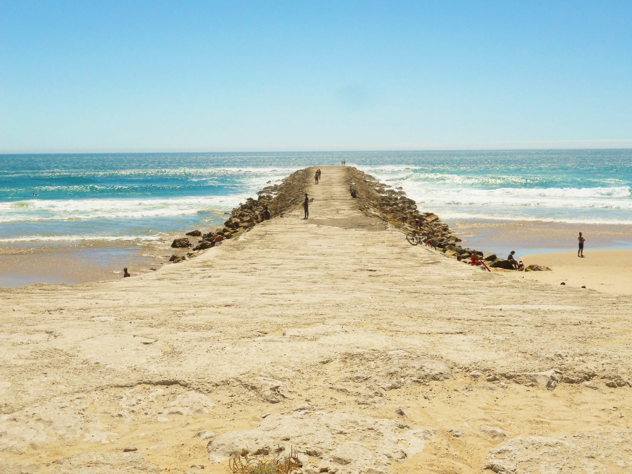 One of pretty piers along Costa da Caparica beaches in Portugal