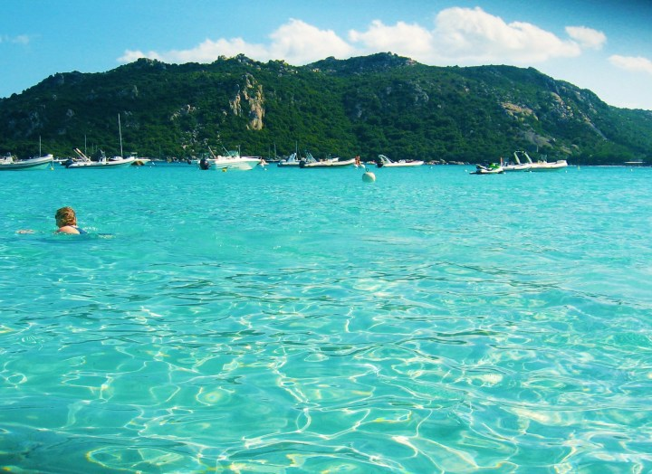 Perfectly cristalline sea just like a swimming pool in Santa Giulia beach in Corsica, France