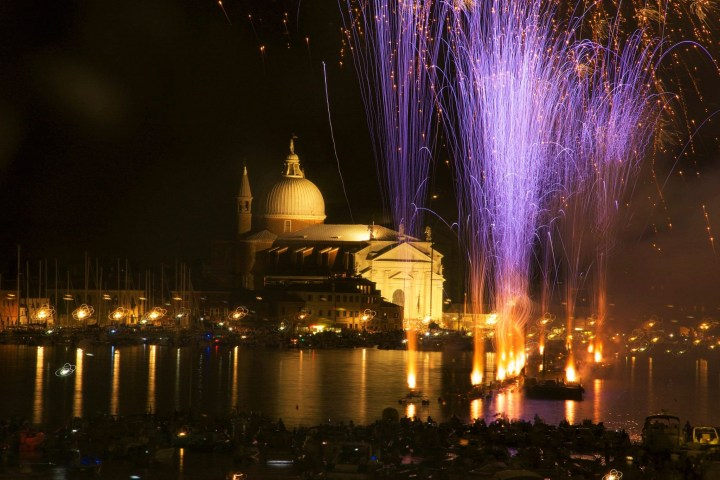 Beautiful fireworks display over the canal of Venice, Italy