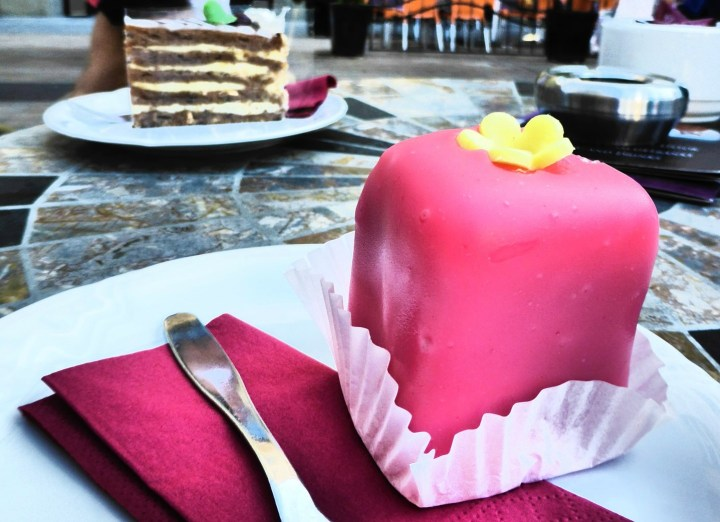 Attractively pink glazed Punschkrapfen are a classical Austrian dessert - Typical Austrian Food