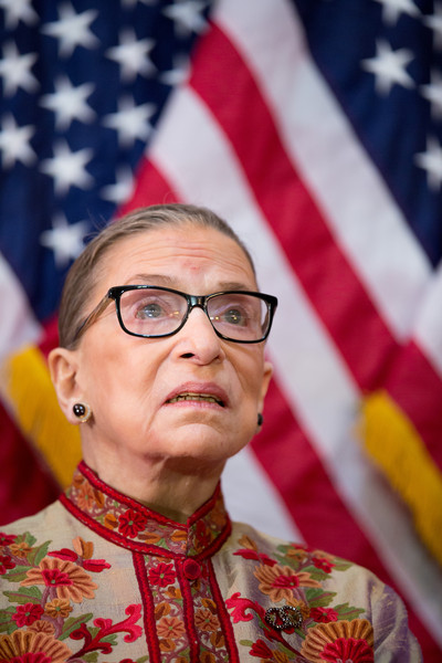 U.S. Supreme Court Justice Ruth Bader Ginsburg participates in an annual Women's History Month reception hosted by Pelosi in the U.S. capitol building on Capitol Hill in Washington, D.C.
