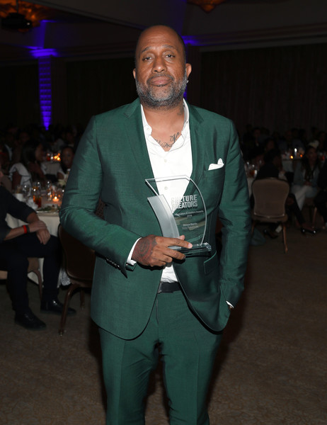 Kenya Barris poses with his award during Culture Creators Leaders and Innovators Awards Brunch 2018 at The Beverly Hilton on June 22, 2018 in Beverly Hills, California.
