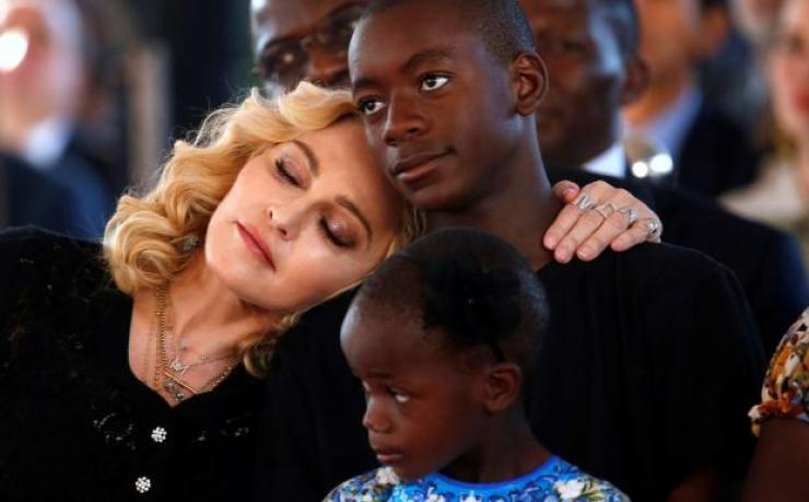 Madonna & adopted black son (getty)