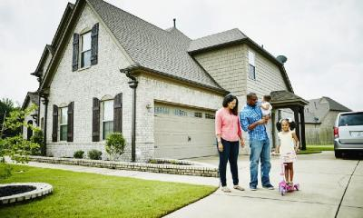 house with black family - GettyImages-659856955