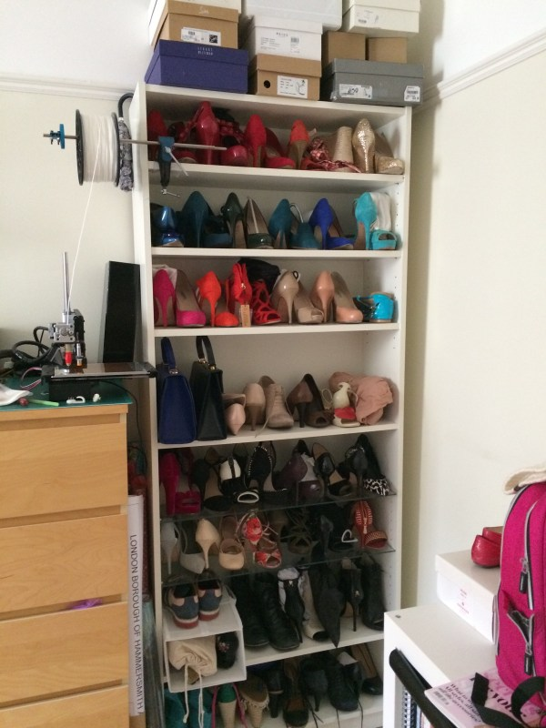 my shoecase. a bookcase full of shoes.