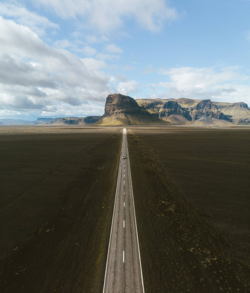 long road to mountains in distance