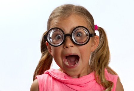 16253695 - little girl wearing big round glasses and making a silly expression