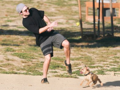 West Hollywood, CA - *EXCLUSIVE* Robert Pattinson is spotted with his fiancee, FKA Twigs' dog, on a fun afternoon at the Dog Park. The English actor keeps it cool in a tee and shorts as he plays fetch with his furry friend. Pictured: Robert Pattinson BACKGRID USA 8 JULY 2017 BYLINE MUST READ: W Blanco / BACKGRID USA: +1 310 798 9111 / usasales@backgrid.com UK: +44 208 344 2007 / uksales@backgrid.com *UK Clients - Pictures Containing Children Please Pixelate Face Prior To Publication*