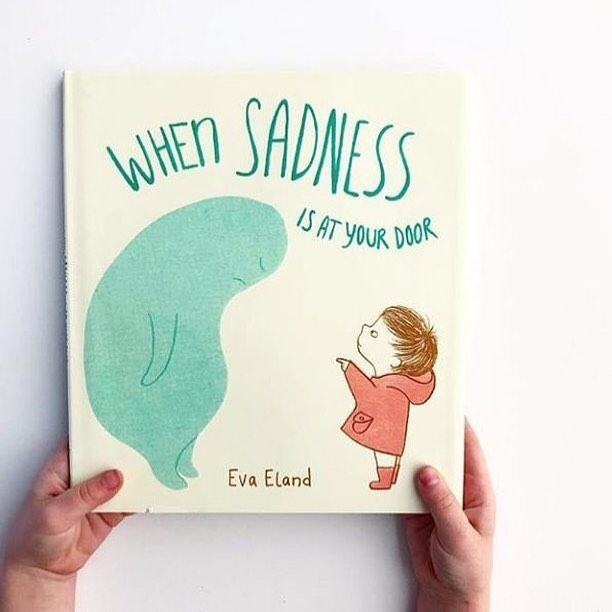 "I'm so pleased that @randomhousekids is the publisher of the American co-edition of my book. I've got many questions from people about this one. As you can see the title is ""When Sadness is at your door"" and the cover is also a little bit different. It also has a dust jacket, with a little bio and photo of me (made by my talented friend @signe_fotar , check out her profile for some beautiful landscape photography) . I don't think this is very uncommon, for books to change cover in different countries? The USA is a different market after all.I can assure you however, the insides of this book are exactly the same. For those that wonder and have asked me about it before. From what I gather, the book is well received in the USA and if you want you can read some of the reviews, of which I put some links on one page on my website (link in bio). Seeing them all together, which isn't even counting all those mentions on social media, is quite overwhelming and I can hardly believe I made this book that people write about. I'm just pretending I find this all very normal and try to go along with it... #evaeland @andersenpress #whensadnesscomestocall @randomhousekids #whensadnessisatyourdoor #picturebook #childrensbookillustration #childrensbooks #mentalhealthawareness #childrensmentalhealth #letstalkaboutsadness #smallactsofselfcare #consolationandcomfort #repost @randomhousekids・・・We have seen such an incredible response to this sweet picture book. We know that talking to your kids about feelings, especially sadness, is NOT easy. In this book, author and illustrator Eva Eland gives sadness a shape and a face, and encourages the reader to give it a name, all of which helps to demystify sadness and distinguish it from ourselves. Shop our #linkinbio for the must-have read.⠀⠀⠀⠀⠀⠀⠀⠀⠀⠀⠀⠀⠀⠀⠀⠀⠀⠀#WhenSadnessIsAtYourDoor #EvaEland #Books #Bookstagram #PictureBooks #EmotionalLiteracy #Reading #ChildrensIllustrations.📸 @book.nerd.mommy"