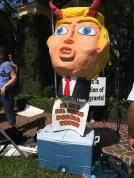 "Sign held by protesters at Donald Trump's Houston fundraiser June 18: ""El hijo del diablo Donald Trump"""
