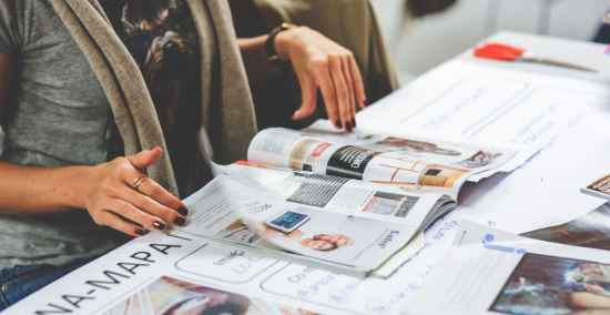 girl reading a newspaper