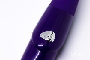 Up close view of the toy branding on the purple toy.
