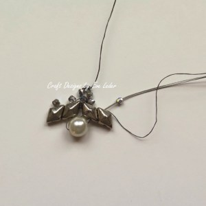 Two Hole Beads Earring--This free beading tutorial includes photos on how to make theses elegant silver and pearl earrings.