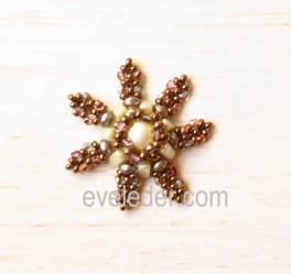 Beaded Snowflake Pattern--Free tutorial. Made with 2-hole Es-o mini beads,2-hole Candy bead, 3-hole eMMA beads, seed beads, and 2Tiny  Fire Polished Beads. Stitches: Peyote and Right Angle Weave.