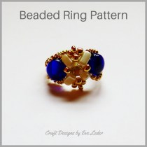 2-hole bead and 3-hole—FREE beading pattern. The ring is worked using the herringbone stitch. It features the 2-hole candy bead and the three-hole EMMA bead.