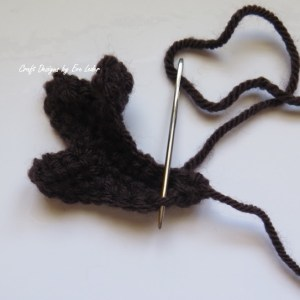 Crochet Reindeer Ornament--start sewing antlers closed at the base.