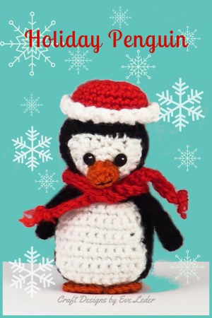 Crochet Penguin — FREE crochet pattern for this festive holiday penguin. This super cute penguin is wearing a red hat trimmed in white and a red scarf.