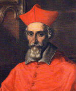 Bearded man wearing red, long clothing.